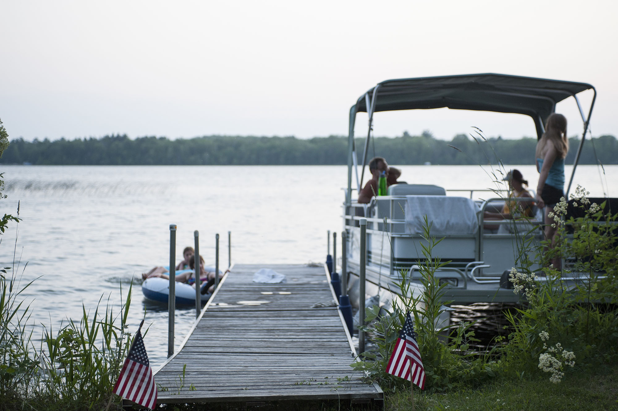 family on playnorth watersports pontoon boat rental at dock in leelanau and traverse city