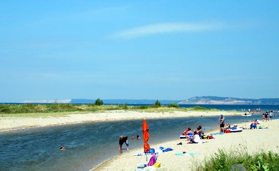 People hanging out on the beach and floating the Platte River in Traverse City Michigan.