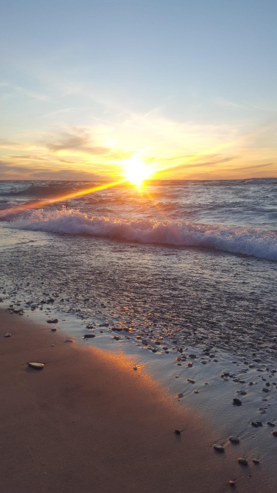 A Beautiful sunset on Lake Michigan at Van's Beach in Leelanau County, Michigan.