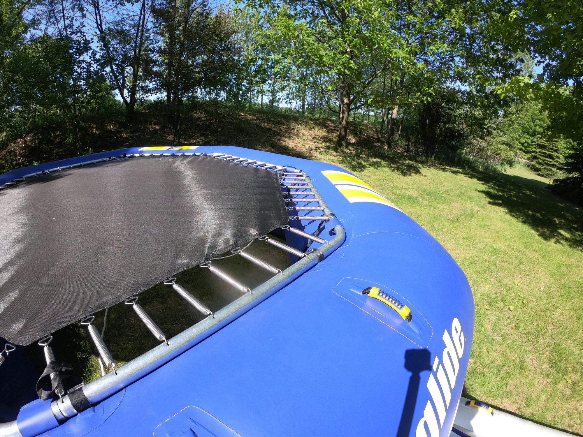 A playnorth water trampoline rental being set up in leelanau county
